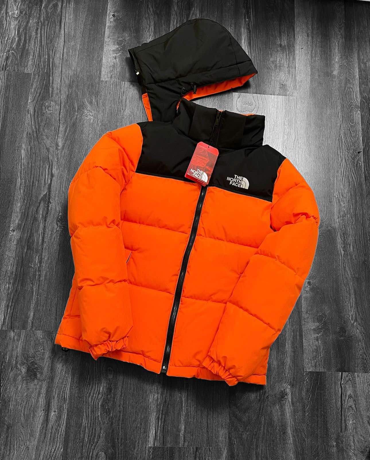 Пуховик оранжевый TNF